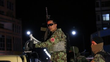 Афганские силовики на месте нападения на отель в Кабуле