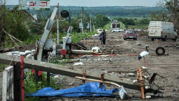 Последствия боев украинской армии с ополченцами в окрестностях Славянска