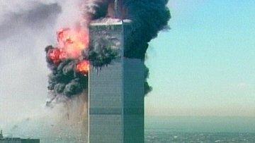 Одна из башен на Всемирного торгового центра в Нью-Йорке во время теракта  11 сентября