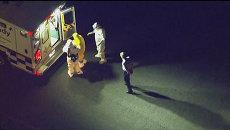 Заразившуюся вирусом Эбола медсестру  в костюме биозащиты доставили в Атланту
