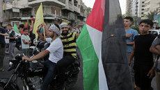 Члены палестинского движения ФАТХ на улицах Газы