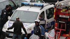 Полиция на месте стрельбы возле офиса издания Charlie Hebdo в Париже