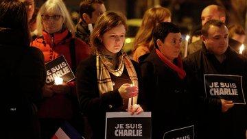 Сотни американцев вышли на улицы в память о жертвах теракта в Париже