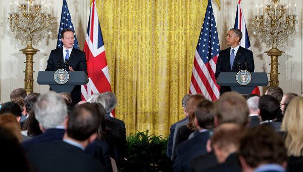 Премьер-министр Великобритании Дэвид Кэмерон и президент США Барак Обама на пресс-конференции в Белом доме. Вашингтон