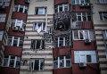 Дом, поврежденный в результате артобстрела в Донецке