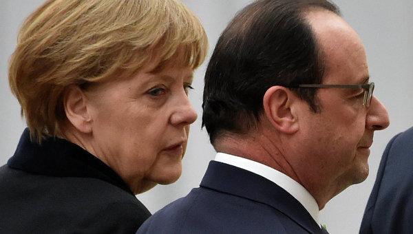 Канцлер Германии Ангела Меркель и президент Франции Франсуа Олланд в аэропорту Минска. Архивное фото