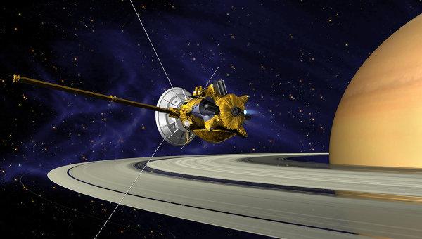 Так художник представил себе Кассини, прибывающий к Сатурну и его спутникам
