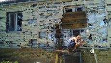 Разрушенный дом в городе Первомайск, Луганская область. Архивное фото