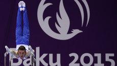 Давид Белявский (Россия) выполняет упражнение на брусьях на I Европейских играх в Баку