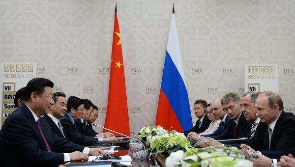 Беседа Президента Российской Федерации Владимира Путина с Председателем Китайской Народной Республики Си Цзиньпином