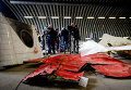 Обломки самолета Boeing 777 в ангаре на авиабазе Gilze-Rijen, Нидерланды