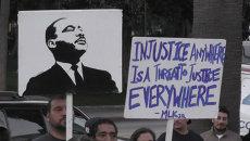 Митингующие в США требовали наказать убивших афроамериканцев полицейских