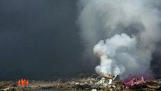 Последствия взрывов на складе опасных веществ в промышленном городе Тяньцзин, Китай. Архивное фото