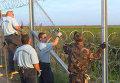 Колючая проволока и забор: Венгрия перекрыла лазейку в Европу для беженцев
