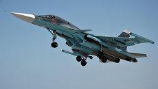 Истребитель Су-34 взлетает с авиабазы Хмеймим в сирийской провинции Латакия. Архивное фото