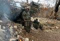 """Бойцы отряда сирийского ополчения """"Ястребы пустыни"""" после возвращения с боевого задания в районе горной гряды Джиб аль-Ахмарна севере провинции Латакия в Сирии"""