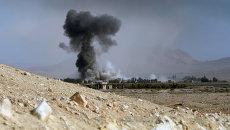 Артиллерийский обстрел позиций боевиков в 20 километрах от города Пальмира