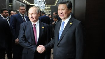 Владимир Путин и Си Цзиньпин во время встречи на полях саммита Группы двадцати (G20), архивное фото