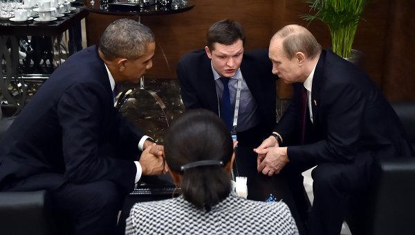Президент России Владимир Путин во время беседы с президентом США Бараком Обамой на полях саммита Группы двадцати (G20)