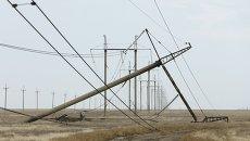 Поврежденный электрический пилон в Херсонской области
