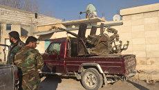 Военнослужащие Сирийской арабской армии на территории взятого под контроль района Мардж аль-Султан