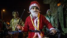 На улицах Дамаска во время празднования Рождества по Григорианскому календарю