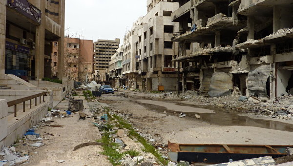Разрушенные в результате боевых действий здания в городе Хомс. Архивное фото