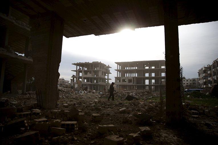 Разрушенные здания в пригороде Дамаска, Сирия