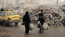 Свалка мусора в городе Алеппо. 2012 год