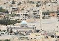 """Вид на центральную часть современной Пальмиры, где продолжаются ожесточенные бои между сирийской армией соместно с отрядами народного ополчения """"Соколы Пустыни"""" и боевиками запрещенной в России организации ИГИЛ"""