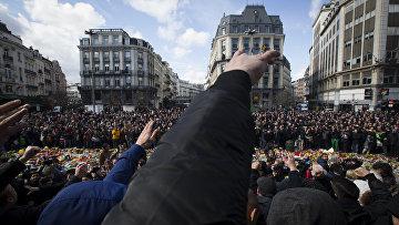Бельгийские футбольные фанаты и националисты во время манифестации в центре Брюсселя. 27 марта 2016