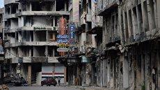 Разрушенные дома на одной из улиц Хомса. Архивное фото