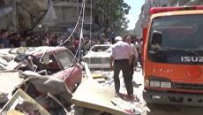 Разрушенные дома и раненые жители - последствия обстрелов боевиками Алеппо