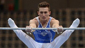 Давид Белявский (Россия) выполняет упражнения на перекладине в командном первенстве среди мужчин на чемпионате Европы по спортивной гимнастике в Берне