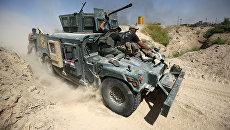 Иракские правительственные войска во время операции против ИГИЛ в городе Эль-Фаллуджа