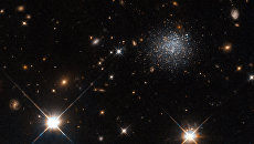Карликовая галактика LEDA 677373, не формирующая новые звезды. Архивное фото