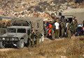 Израильские военные на месте взрыва гранаты на Голанских высотах