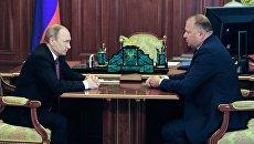 Президент России Владимир Путин и губернатор Калининградской области Николай Цуканов во время встречи в Кремле. 27 июля 2016