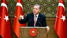 Президент Турции Реджеп Тайип Эрдоган выступает на экономическом форуме в Анкаре. 2 августа 2016