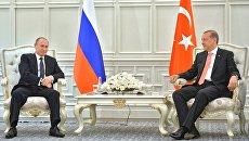 Президент России Владимир Путин и президент Турции Реджеп Тайип Эрдоган во время встречи в Баку. 13 июня 2015 года