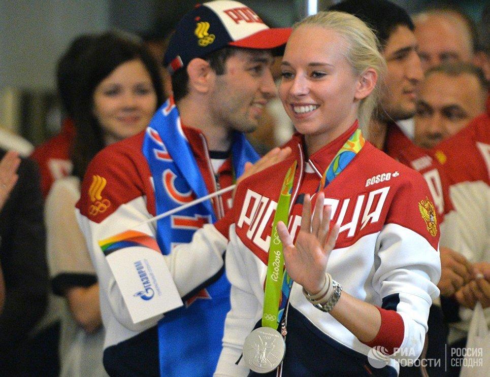 Яна Кудрявцева во время церемонии встречи в аэропорту Шереметьево