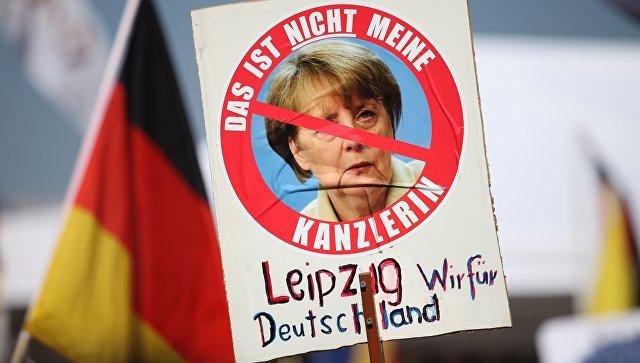 Акция протеста против политики Ангелы Меркель в Берлине