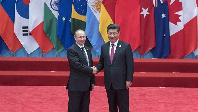 Президент РФ Владимир Путин и председатель КНР Си Цзиньпин на церемонии официальной встречи глав делегаций государств-участников Группы двадцати G20, приглашенных государств и международных организаций в Ханчжоу
