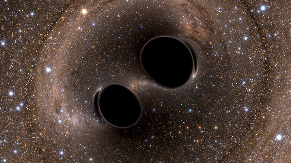 Кадр моделирования столкновения двух черных дыр в космосе