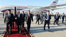 Владимир Путин во время церемонии встречи в аэропорту Бишкека. 16 сентября 2016