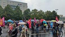 Участники акции протеста против TTIP в Берлине