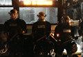 Сотрудники полиции во время акции протеста в Северной Каролине из-за убийства полицейским афроамериканца