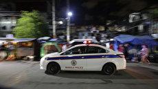 Машина полиции на улице Манилы, Филиппины. Архивное фото