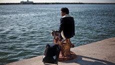 Иностранные беженцы в порту Бенгази. Архивное фото