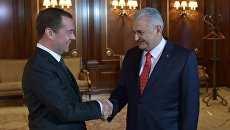 Председатель правительства РФ Дмитрий Медведев и премьер-министр Турции Бинали Йылдырым во время встречи в подмосковной резиденции Горки. 6 декабря 2016